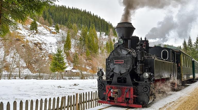 Mocanita steam engine traine on Vaser river valley in Maramures