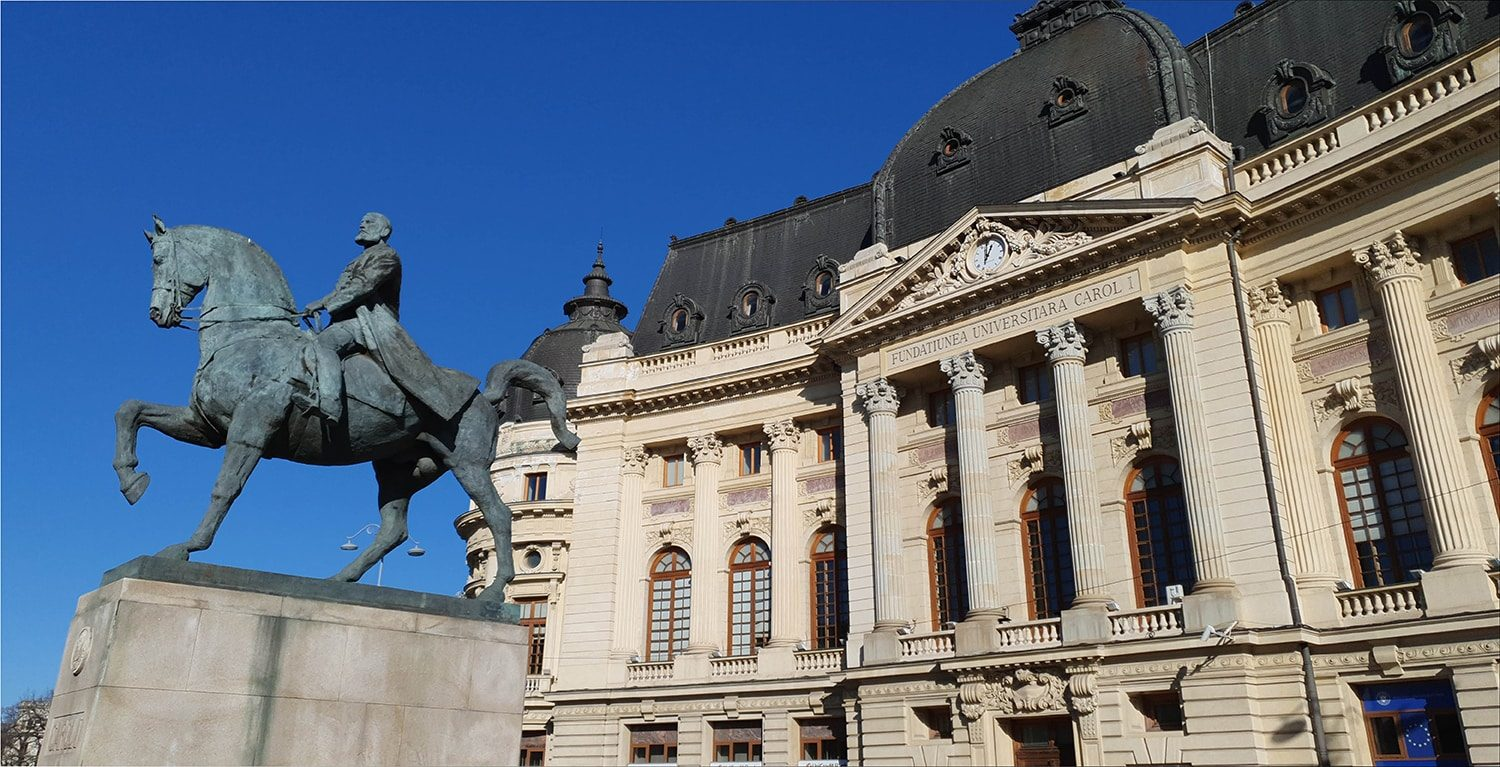 Equestrian King Carol I statue and University Library in Bucharest